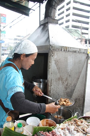 Street food vendor in Bangkok, Thailand - 29.07.2011 Stock Photo - 12943552