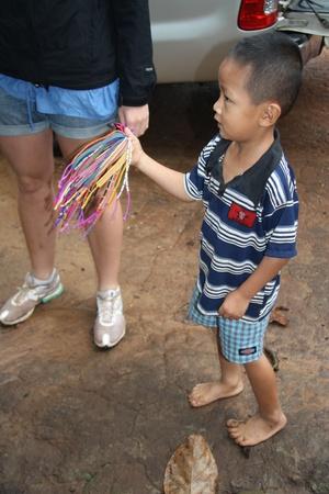 spliced: Child seller of souvenirs, Karen village, Chiang Mai, Thailand