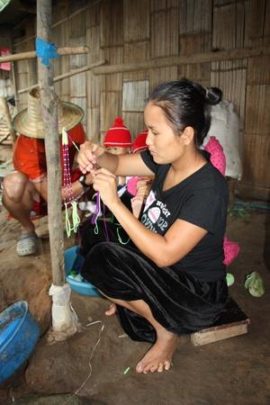 Traditional braiding in Karen tribal village, Chiang Mai, Thailand - 31.07.2011 Stock Photo - 12992928