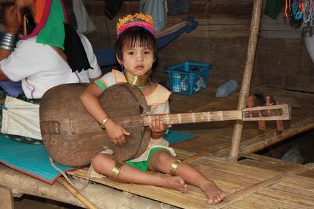 mai: Karen Child playing guitar, Northern Thailand, Chiang Mai - 31.07.2011 Editorial