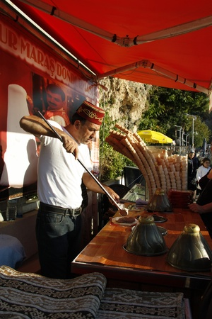 Ice cream street vendor in traditional Turkish cap in Antalya, Turkey - 29.11.2011