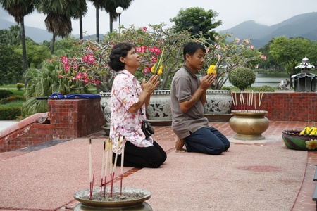 People pray in Buddhist temple, Thailand - 02.08.2011