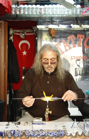 Glass blower forming a piece of glass in Turkey, Antalya - 29.11.2011
