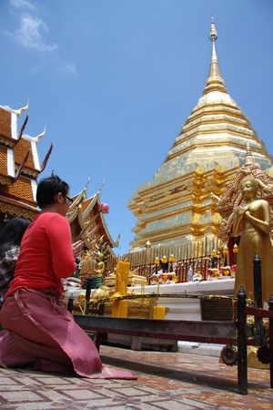 Pray in Buddhist temple Wat Doi Suthep, Chiang Mai, Thailand - 26.07.2011 Stock Photo - 13365517