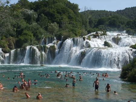 stupendous: People rest at Amazing KRKA Waterfall in Croatia - 10.08.2009 Editorial