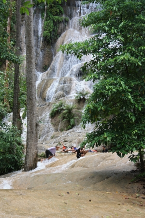 Happy tourists have fun at the beautiful waterfall in Thailand - 05.08.2011 Stock Photo - 13626753