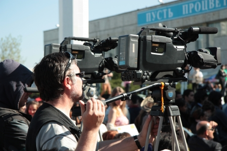 film crew: TV reporter working on the street during the public event, Moscow, Russia - 04.05.2012
