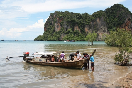 Tropical coastal landscape with a longtail boat with tourists, Krabi, Thailand - 14.08.2011 Stock Photo - 14050399