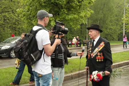 Reporters interview the Veteran of War during Victory Day in Moscow, Russia - 09.05.2012