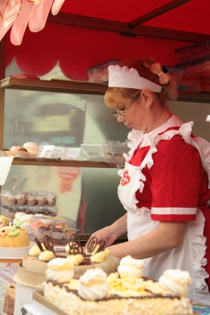 Female confectioner preparing holiday cakes, Moscow, Russia - 01.06.2012