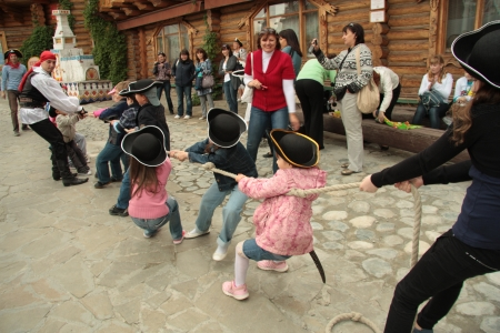Children play in tug of war at the holiday, Moscow, Russia - 01.06.2012