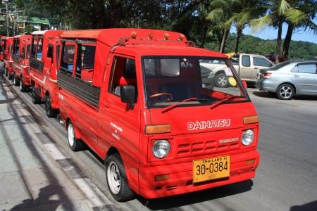 tuk tuk: New style red tuk-tuk taxi in Patong, Phuket Island, Thailand - 08.08.2011