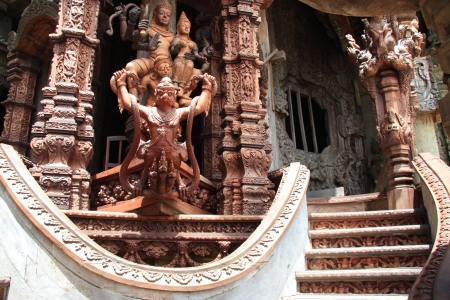 Beautiful carved wooden stairs of the Sanctuary of Truth Temple in Pattaya, Thailand photo