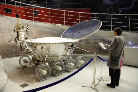 People watching Lunar rover for study of the Moon in the Astronautics museum in Moscow, Russia - 14.01.2012