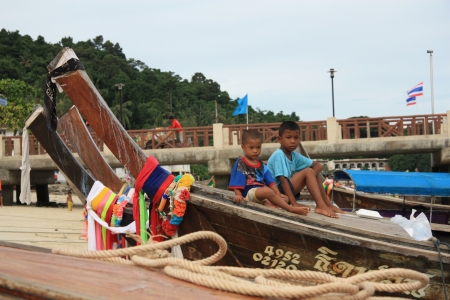 Children at Long Tail boats at the coast of Phi Phi island in Thailand - 11.08.2011