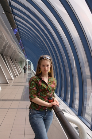 Young attractive woman in corridor of modern building photo