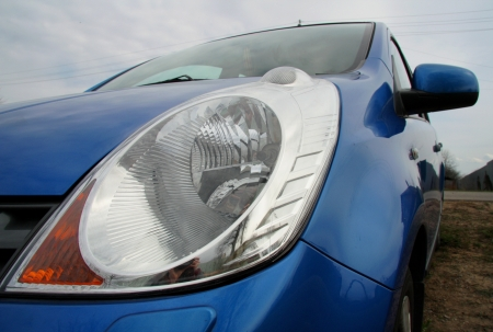 car front: Close up view of car headlight Stock Photo