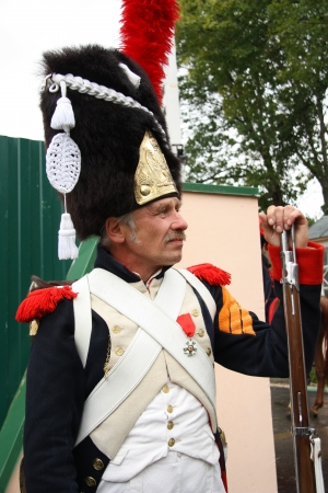 reenactor: French Napoleonic Guard Grenadier in a uniform at the Reconstruction of military battle between Russian and French armies under Borodino in 1812, Russia - 03.09.2012