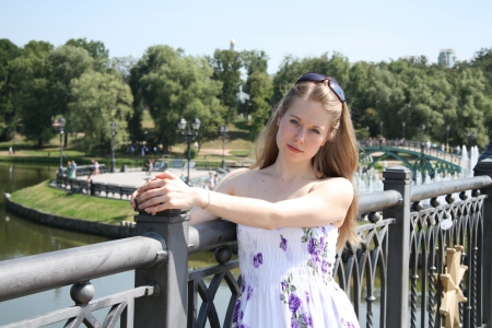 tsaritsino: Pretty blond girl at the city park on a summer day
