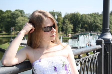 tsaritsino: Pretty blond Caucasian girl in the city park on a summer day