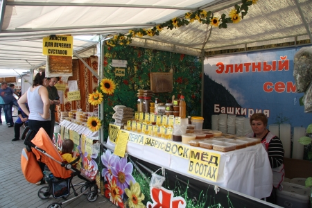 Customers are testing and buying honey at the market, Moscow, Russia - 15.08.2012