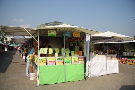 Customers are testing and buying honey at the outdoor market, Moscow, Russia - 15.08.2012