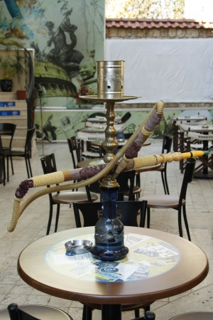 Shisha Pipe in a glass wooden table outdoor in a street cafe in Antalya, Turkey