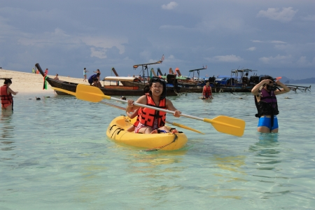 Happy People kayaking and snorkeling in a crystal water of Andaman sea, Thailand, Phi Phi island - 13.08.2011
