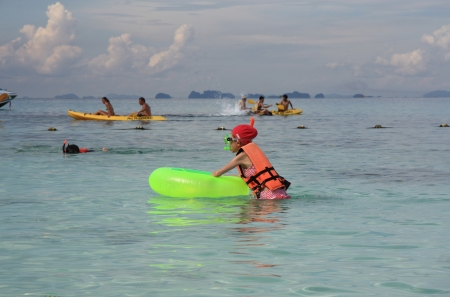 People kayaking and snorkeling in a crystal water of Andaman sea, Thailand, Phi Phi island - 13.08.2011