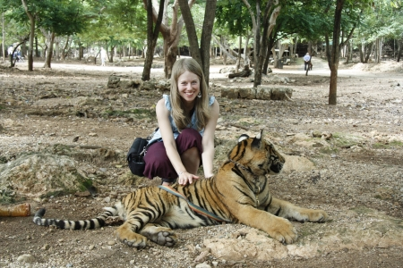 Caucasian young tourist woman and the Tiger in a Tiger Temple, Kanchanaburi province, Thailand Reklamní fotografie