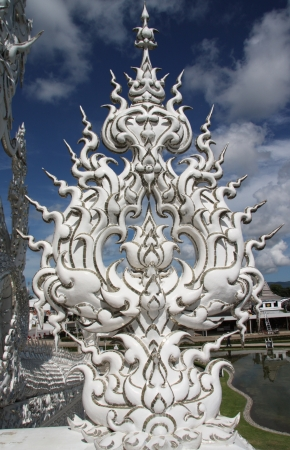 Sculpture in the famous buddhist White temple Wat Rong Khun, Chiang Rai, Thailand photo