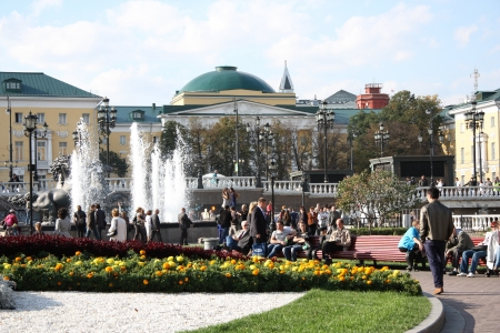 People have rest at Manezhnaya Square at sunny day in center of Moscow, Russia - September 20th, 2012