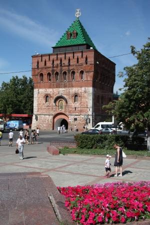 gorky: People walk near Dmitrovskaya Tower of Nizhny Novgorod Kremlin at the Minin and Pozharsky Square, Russia - August 07th, 2012