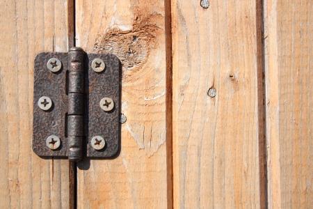 hinge: Door hinge on wooden door