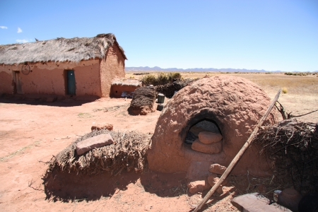 homestyle: Traditional clay house with a outdoor oven in Bolivia