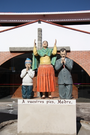 church group: Family pray statue at the church, Copacabana, Bolivia, South America Stock Photo