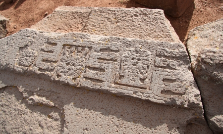 architectural heritage: The Ruins of Tiwanaku with ancient pattern, closeup with images of the Sun and condors, Bolivia