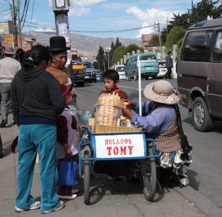 Ice cream seller in a street of La Paz, Bolivia, South America - 27 08 2013