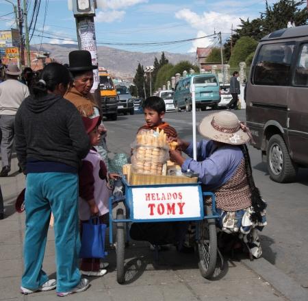 Ice cream seller in a street of La Paz, Bolivia, South America - 27 08 2013