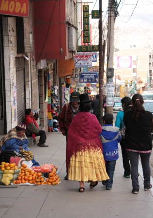 People trading and walking in a street of La Paz, Bolivia, South America - 27 08 2013