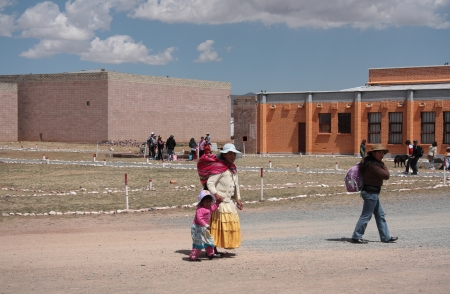 People at the square of Tiwanaku archaeological site, Bolivia, South America - 08 09 2013