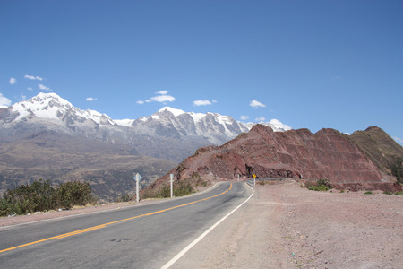 suspense: Empty mountain road stretches into the distance in South America Stock Photo