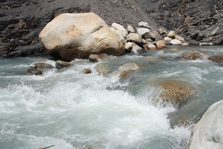 rushing water: Rushing water of rapids at the mountain river Stock Photo