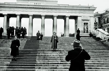 Soviet people walk at Earl Pier Colonnade - landmark of Sevastopol, USSR, 1950th