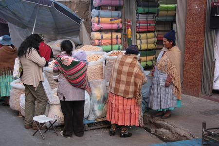 latin child: People buy food in a street of La Paz, Bolivia - 13.08.2013