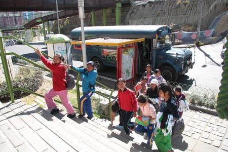 Bolivian school children walking in a park after classes at primary school, La Paz, Bolivia - 13.08.2013