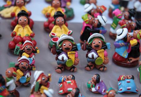 souvenir traditional: Miniature funny figures of Bolivian native people, La Paz, Bolivia Stock Photo