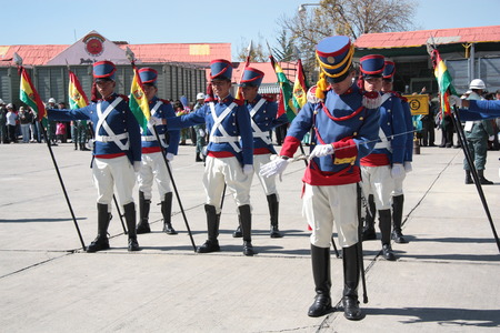 ceremonial clothing: Bolivian soldiers in traditional uniform with flags and saber - 31.08.2013 Editorial