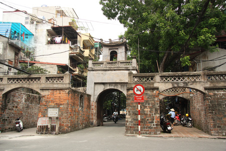 Old street of Hanoi with Ancient Quan Chuong Gate, Vietnam - 08.08.2014