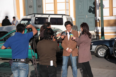 Bolivian politician gives official interview to reporters in front of Government Palace of Bolivia, La Paz - 22.08.2013